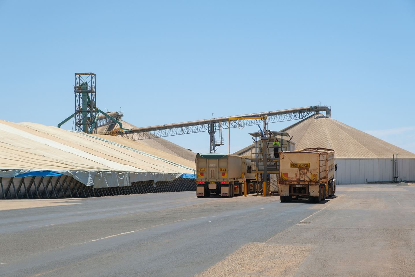 Two trucks lining up at the CBH site sample hut to be sampled at harvest