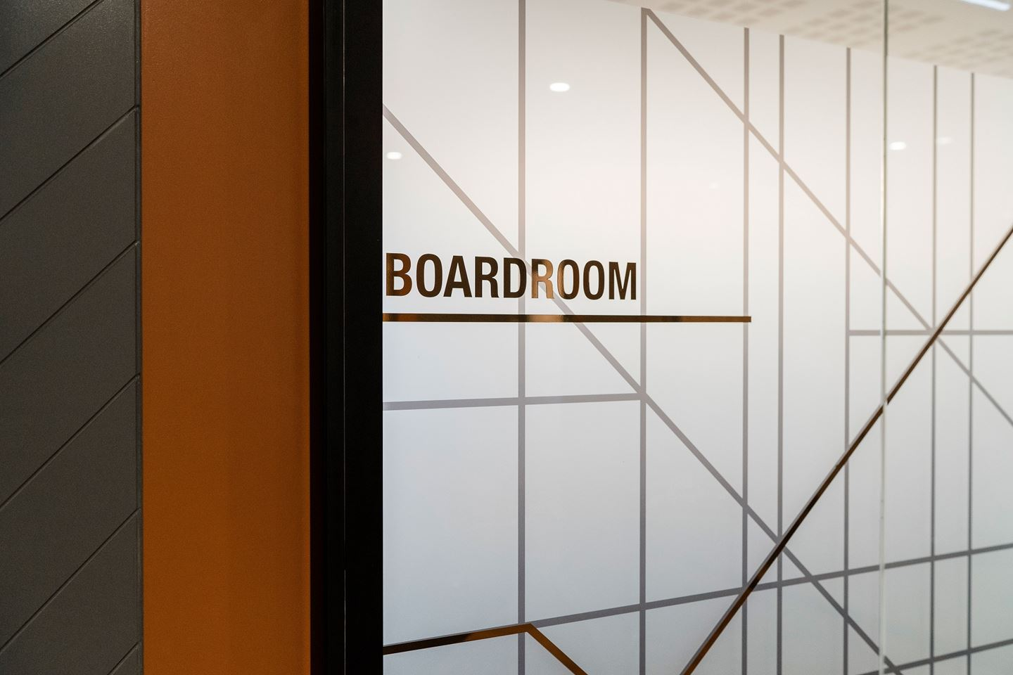 Close up of the CBH Head Office Boardroom door with bronze foil lettering on glass which reads 'Boardroom'