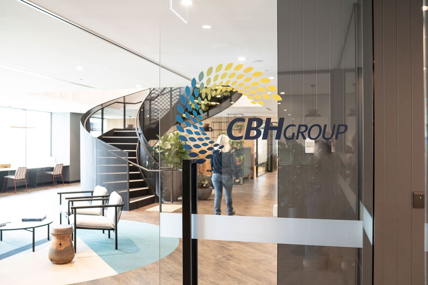 A glass door with the CBH Group logo shows the reception area and spiral staircase of CBH Head Office behind it